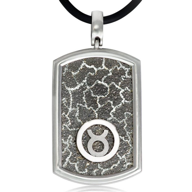 Alex Soldier Tag Necklace Pendant with Taurus zodiac sign is made in sterling silver, infused (deeply plated) platinum (rhodium). Suspended on 18-inch rubber cord, it features signature metalwork that creates an effect of inner sparkle. Handmade in