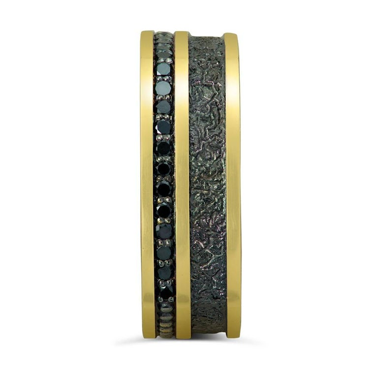 Alex Soldier's Black Diamonds Men's Ring Band in 18 karat yellow gold and signature metalwork. Handmade in NYC. One of a kind. Ring size: 10. Complimentary ring sizing is available within 2 business days.   About The Artist: Known for his elaborate