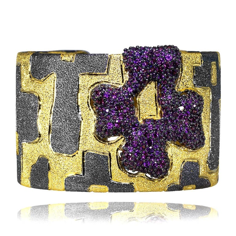 Since ancient times, wide bracelets or cuffs formed an essential part of women's and men's wardrobes. Made of precious metals, they served not only as an ornament but also as a talisman. It was believed that a cuff, tightly fitting the wrist, would