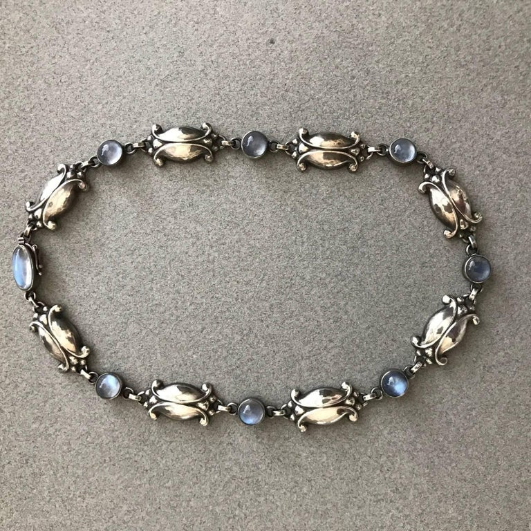 Georg Jensen Vintage Sterling Silver Necklace No. 15 with Moonstones  This is a gorgeous example of a necklace that can be worn day or evening. Beautiful patina on the sterling silver and the moonstones have a bright, opalescence quality. The links