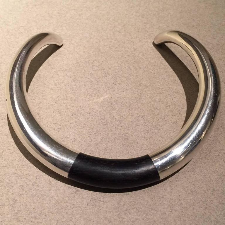 Georg Jensen Sterling Silver and Ebony Neck Ring No. A29A by Anne Ammitzbøll  Fabulous vintage piece from 1978. Bold, modern design. Neck ring is in excellent condition.  Please note that this piece is for a person with a petite neck.   Dimensions: