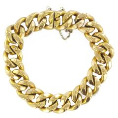French 19th Century Chiselled Gold Charm Bracelet