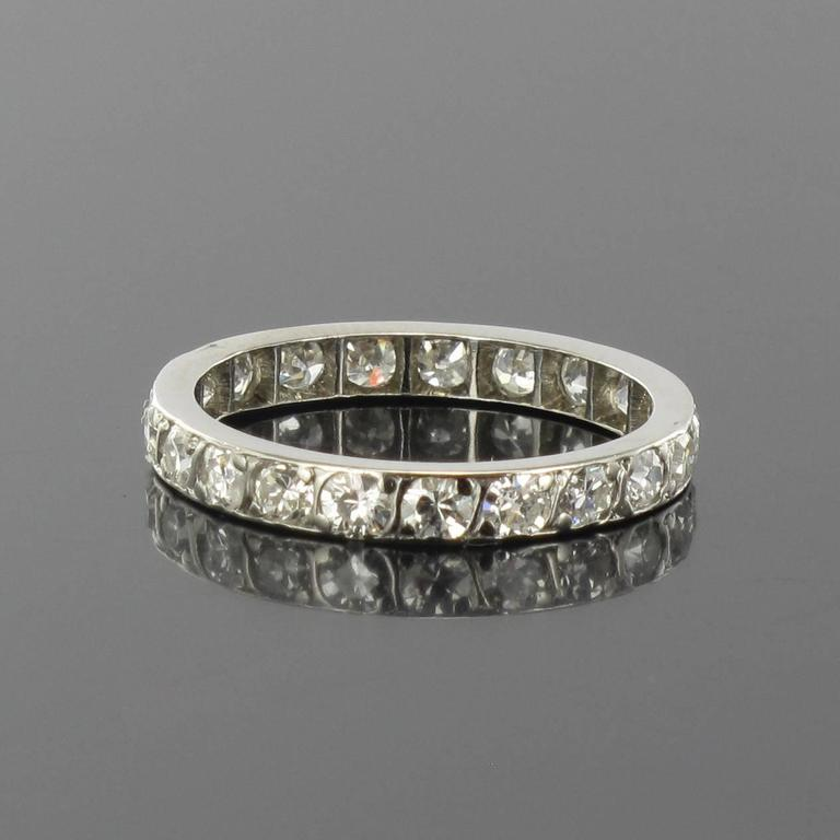 Ring in platinium.   This splendid platinium eternity ring features brilliant cut diamonds. Total weight of diamonds: 1 carat about.  Weight: approximately 2 g.  Width: 2,6 mm  US Size : 5,5, Other size, please contact us.   Our opinion : Displaying