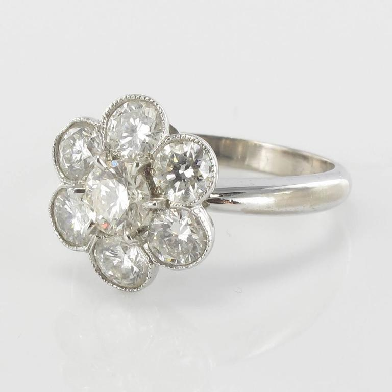 Ring in 18 carat white gold, eagle head hallmark. 