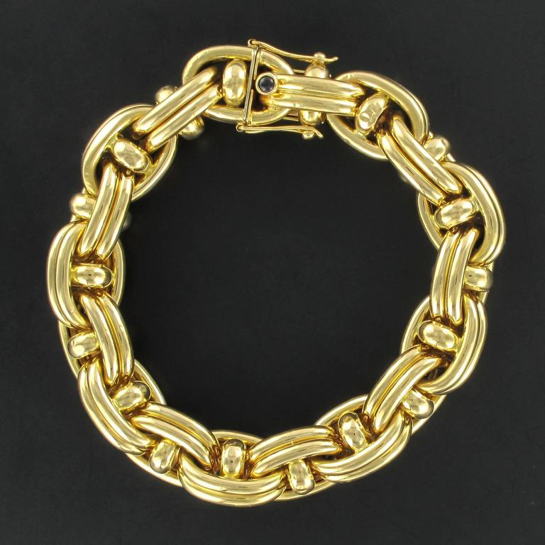 Bracelet in 18 carat yellow gold, eagle head hallmark.   This bracelet, signed Caplain, is composed of a double anchor link chain. The clip clasp with a safety 8 feature is hidden within the end links. The clasp is bezel set with a small round