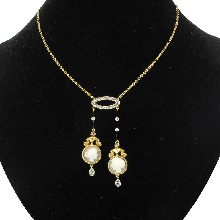 Necklace in 18 carat yellow gold, eagle head hallmark.  A superb antique yellow gold lavalier necklace composed of an oval motif set with rose cut diamonds with 2 asymmetric gold hearts featuring bezel set rose cut diamonds in beaded surrounds and a