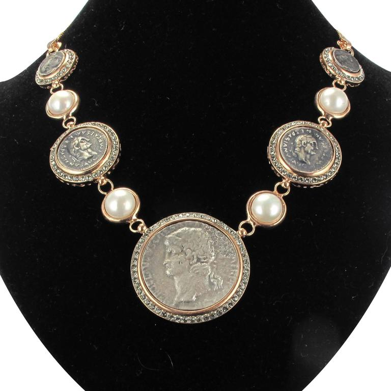 Necklace in vermeil, silver and rose gold.  It consists of a fall of antique style pieces made of glass paste surrounded by crystals and separated between its by glass beads enclosed. The chain is a double snake mesh.  The necklace ends in a chain
