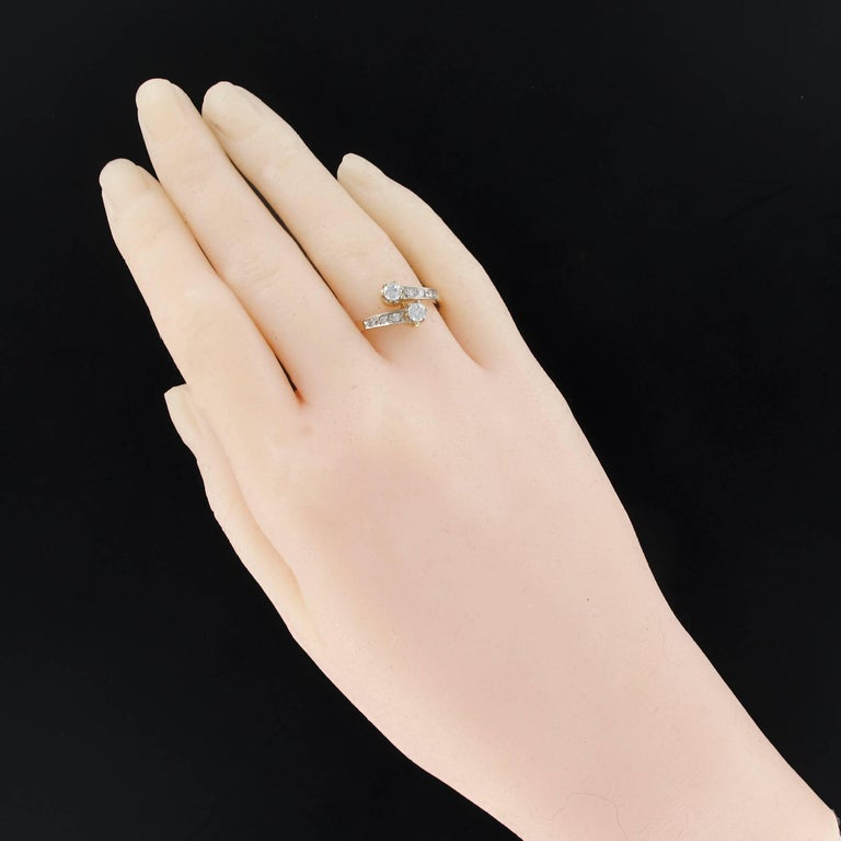 Ring in 18 carat yellow gold,, eagle head hallmark and platinum. Called ring toi et moi, it is set with claws on its top of 2 brilliant cut diamonds. The start of the ring is set millegrains of 2 X 3 brilliant cut diamonds. Total weight of center