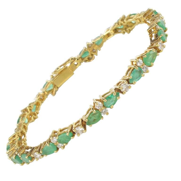 1980s 18 Carat Yellow Gold Diamonds Emeralds Tennis Bracelet
