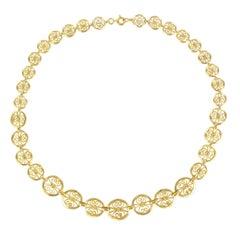 1960s Retro Filigreed Openwork Round Motif 18 Karat Yellow Gold Necklace