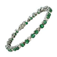 1980s 5.90 Carat Emerald Diamond Silver Tennis Bracelet