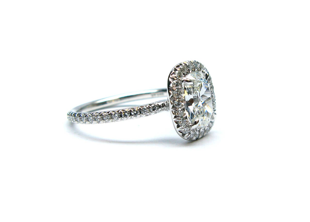 """This GIA certified 1.12 carat G color Internally Flawless clarity cushion cut diamond is beautifully set in a platinum and diamond frame ring. This gorgeous ring holds 48 pave diamonds totaling  0.32ctw. Any lady would  be lucky to say """"YES"""" to this"""