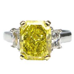 2.52 Carat GIA Fancy Vivid Yellow Radiant Diamond Gold Platinum Ring