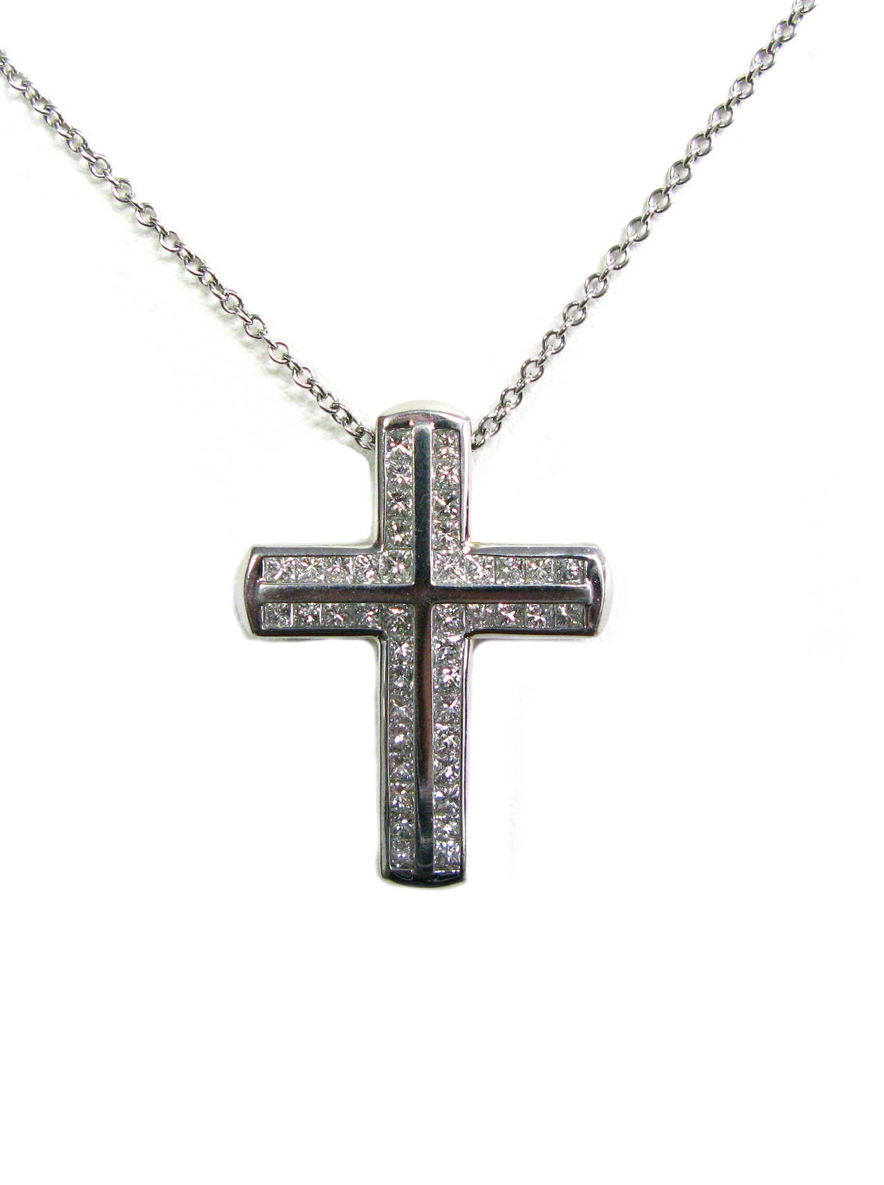 This beautiful necklace is part of the Kurt Wayne collection. This heavyweight platinum cross pendant features rows of channel set princess cut diamonds totaling 1.85cts and is suspended from a 16