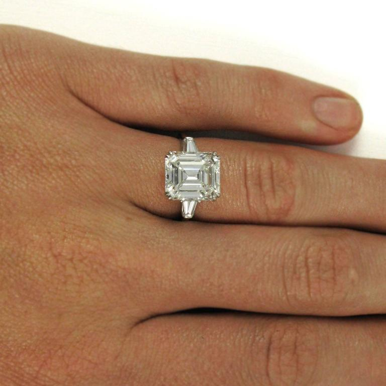 Two Solitaire Emerald Cut In One Ring