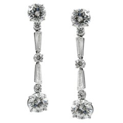 Round and Baguette Cut Diamond and White Gold Line Drop Earrings