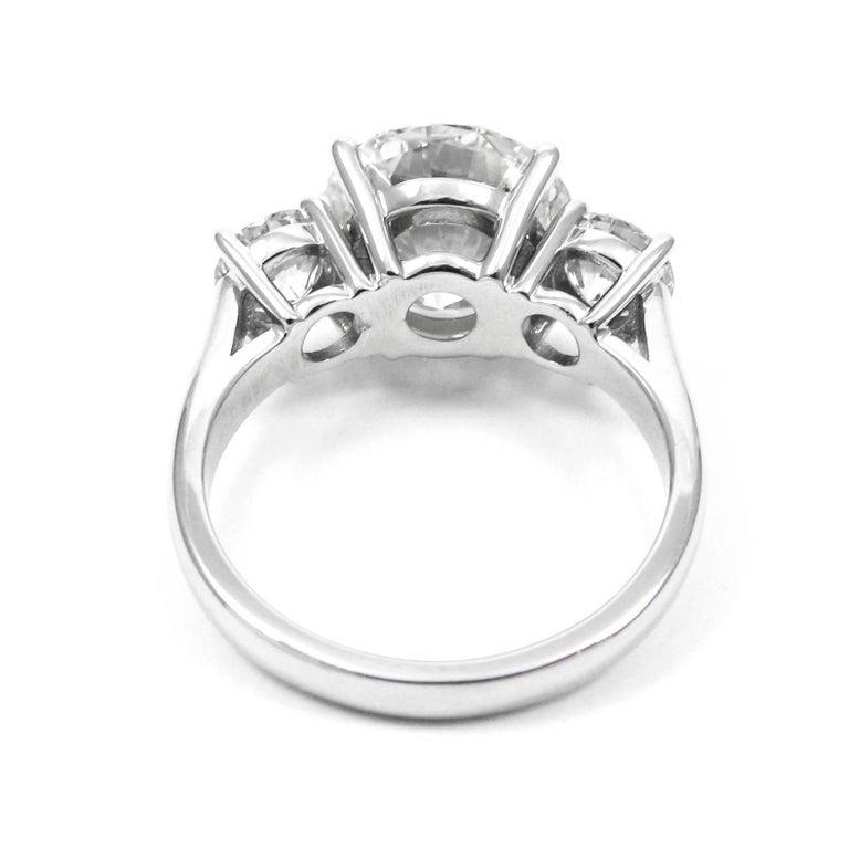 Women's or Men's 5.17 Carat Total Round Brilliant Cut Diamond Three-Stone Platinum Ring GIA For Sale