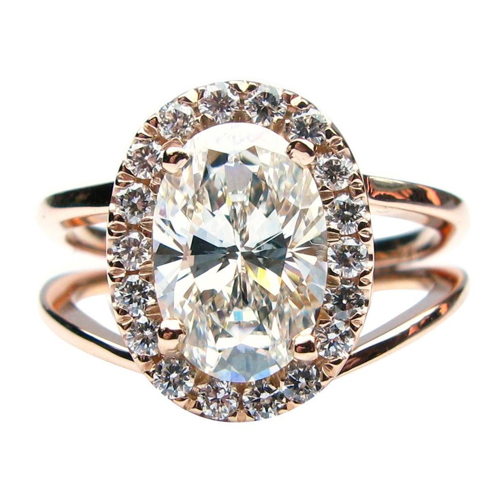 GIA Certified 1.70 Carat Diamond Gold Oval Frame Ring at 1stdibs