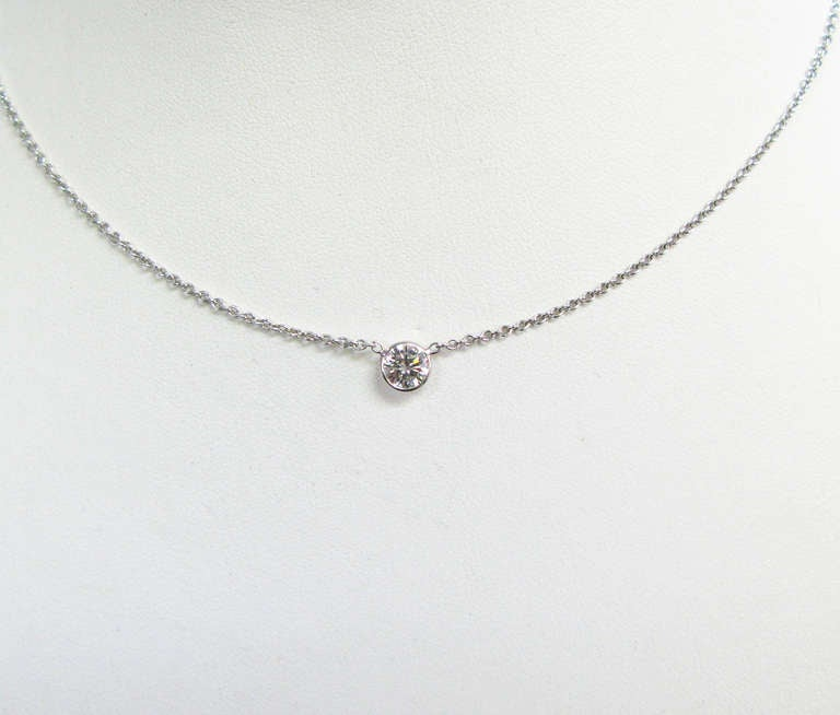 This handmade bezel set 0.75 carat round brilliant diamond pendant is set in 18kt white gold. This piece is simple and classic. It is dainty enough to wear on an everyday basis, but bold enough that it will definitely catch everyone's eye. Perfect