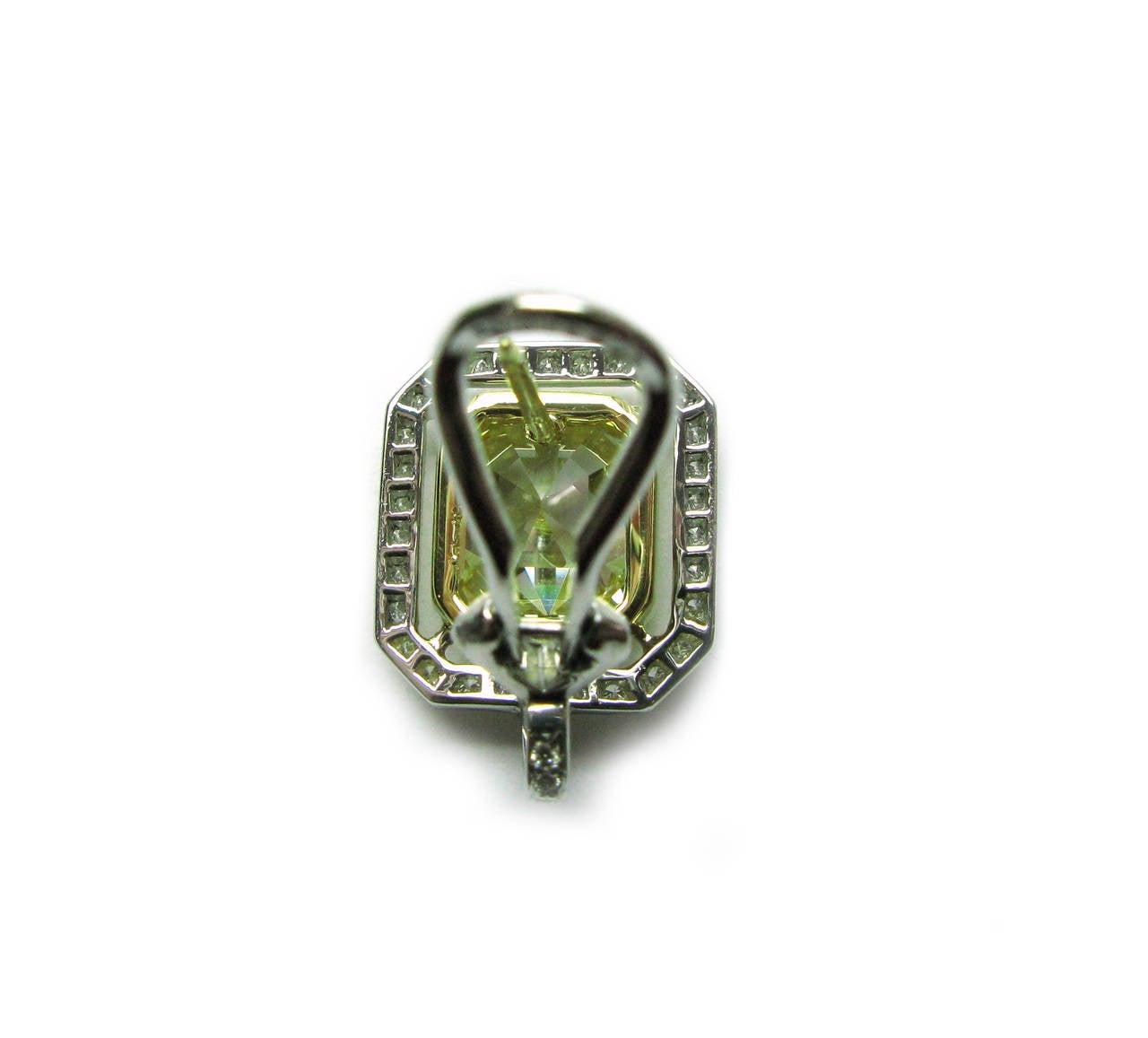 Women's 6.70 Carat GIA Cert Fancy Yellow Emerald cut  Diamond Frame Earrings For Sale