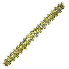 Fancy Color Diamond Tri Color Gold Tennis Bracelet