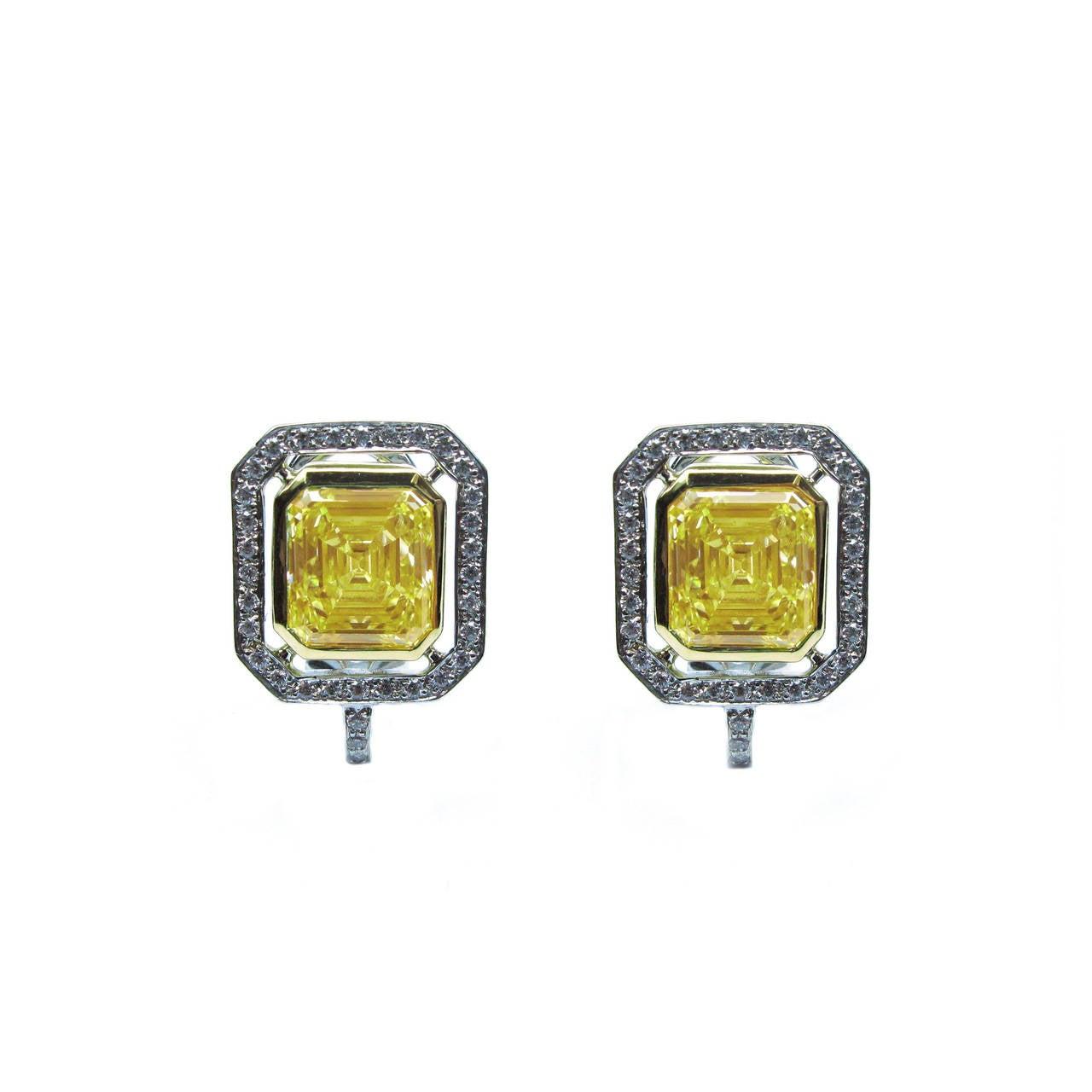 6.70 Carat GIA Cert Fancy Yellow Emerald cut  Diamond Frame Earrings For Sale