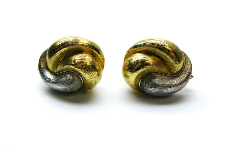 These Henry Dunay signed clip earrings weighing 23.19g are designed using 18Kt yellow gold and platinum in a swirled pattern. They are perfect for everyday wear and are sure to add a touch of elegance to all your outfits. Make these a part of your
