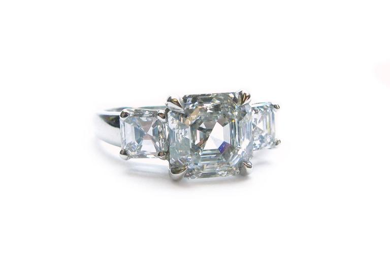 Asscher Cut 3.01 Carat GIA F VS1 Certified Asscher Diamond Platinum Three Stone Ring For Sale