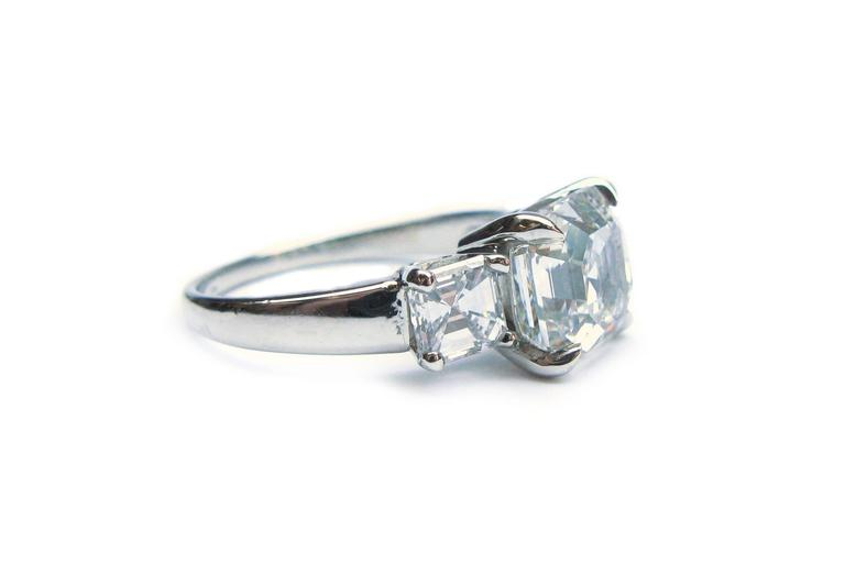 3.01 Carat GIA F VS1 Certified Asscher Diamond Platinum Three Stone Ring In New Condition For Sale In New York, NY