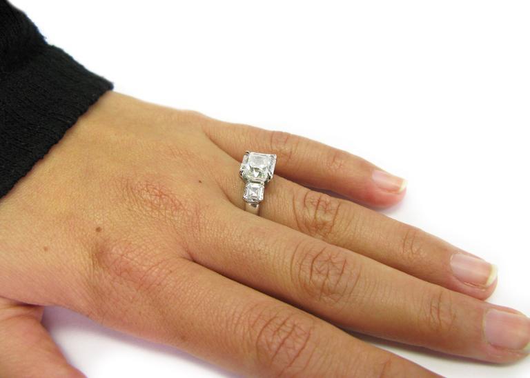 3.01 Carat GIA F VS1 Certified Asscher Diamond Platinum Three Stone Ring For Sale 2