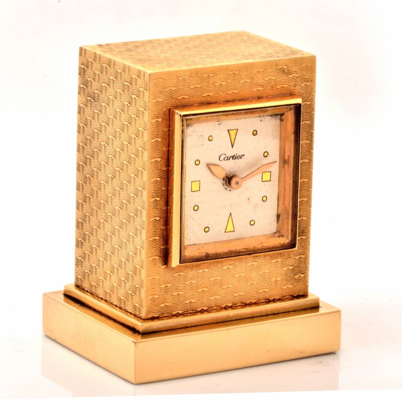 This aesthetically captivating authentic circa 1950 Cartier eight-day desk clock with a 14K yellow gold case weighs 117.2 grams and measures 2 1/8