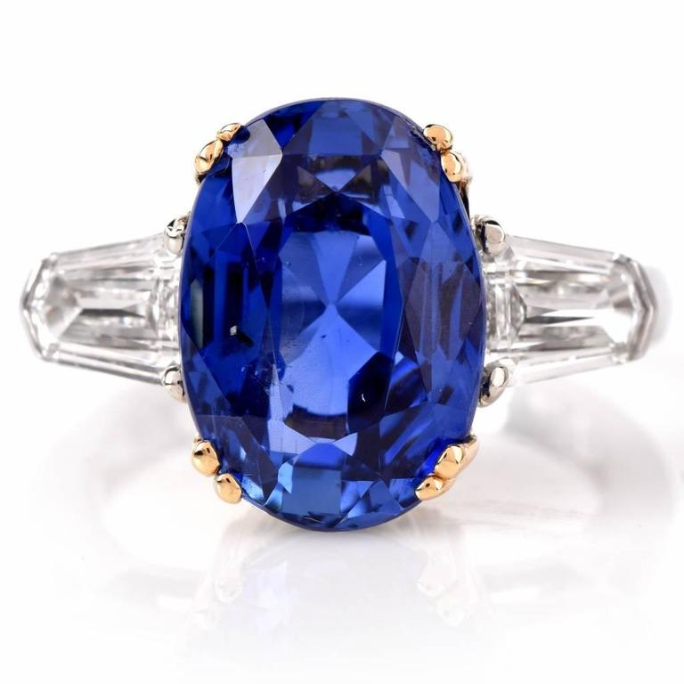 This exceptional sapphire ring of classic elegance is crafted in platinum and 18K yellow gold It exposes an oval shape rare natural corundum sapphire with Burma (Myanmar) origin, GIA certified indicating no heating or treatment. Natural sapphire