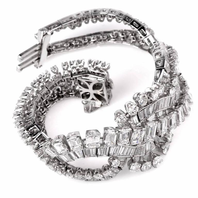 Retro Wide Emerald Cut and Round Diamond Platinum Bracelet In Excellent Condition For Sale In Miami, FL