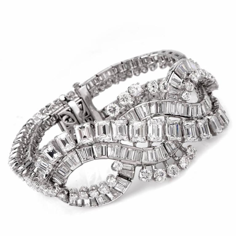 This captivating retro bracelet of sophisticated elegance and outstanding workmanship is crafted in solid platinum, weighing 84.5 grams and measuring 7.1/4