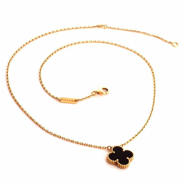 2ab81b92daa5 Van Cleef   Arpels Alhambra Onyx Gold Clover Pendant Necklace In New  Condition For Sale In