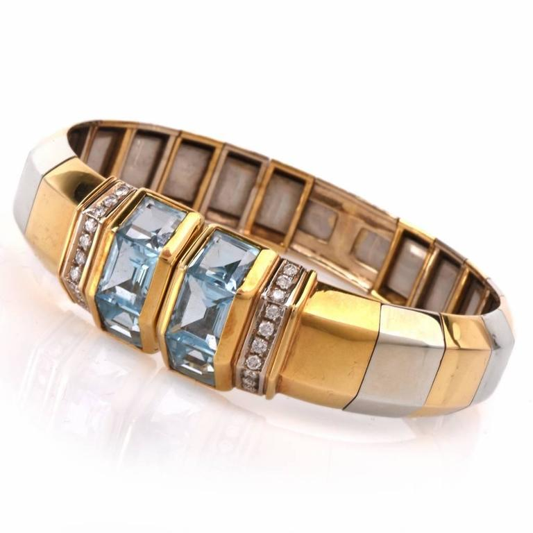 This  sparkling cuff bracelet crafted in solid  high polish 18K yellow gold. It is showcasing a geometric cuff design, featuring 6 square step cut aquamarine stones approx: 8.30cttw, channel set and accented with 20 genuine round cut Diamonds