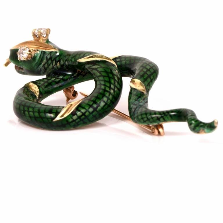 This enchanting Diamond enamel brooch pin is crafted in solid 14K yellow gold. Showcasing a French green enameled snake set with 2 genuine antique old mine Round cut Diamonds of approx: 0.35 cttw, I-J color, Vs1 clarity, prong set, this animal