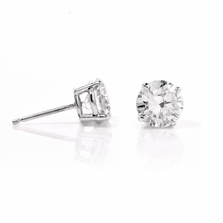 These sparking Certified diamond stud earrings are crafted in solid 18K white gold, weighing approx. 1.5 grams and measuring 7.2  mm in diameter. These stunning earrings expose two brilliant-cut diamonds weighing approx. 2.13 ct in total. One