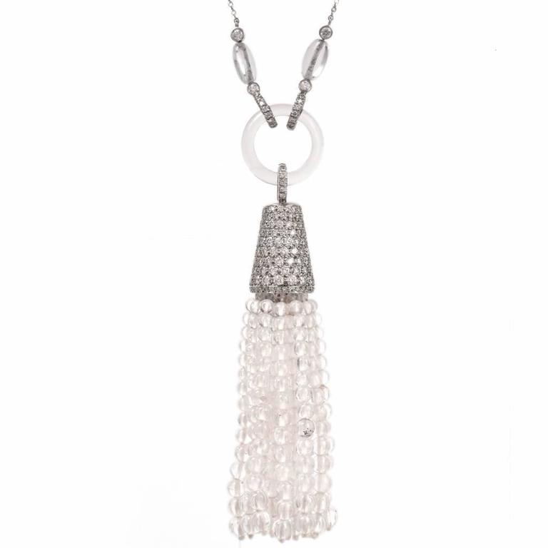 """This breathtaking Tiffany & Co. Art Deco inspired tassel necklace of gracious feminine aesthetic is reminiscent of the glorious 1920's, incorporating a 22"""" long platinum chain enriched with 12 rock crystal oval beads, each flanked by a pair of"""