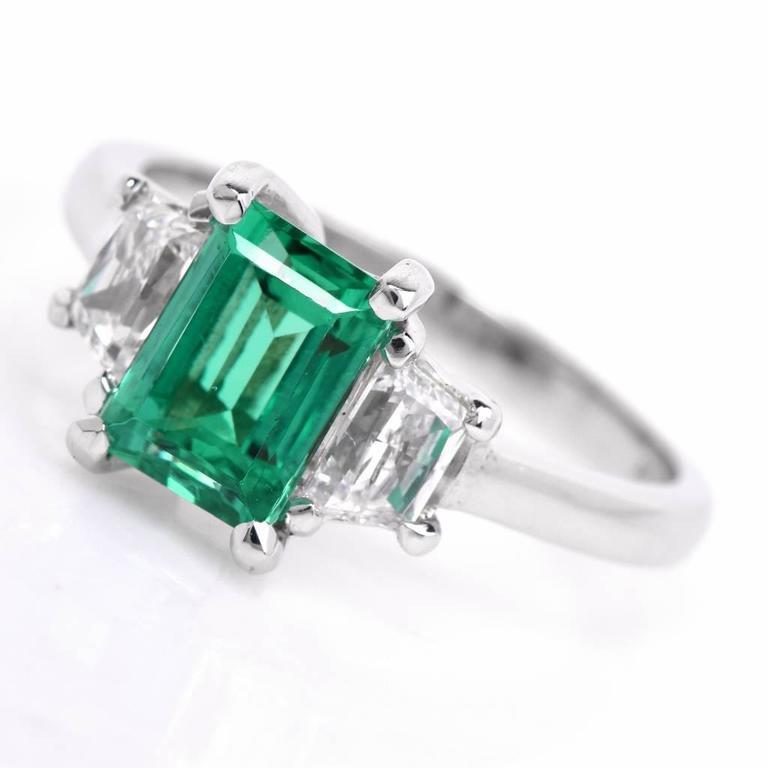 emerald platinum three engagement ring for