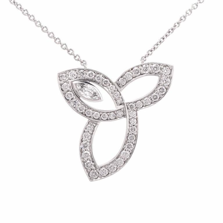 Harry winston lily cluster diamond platinum pendant necklace for this authentic harry winston pendant from the popular lily cluster collection combines contemporary elegance and tradition aloadofball Images
