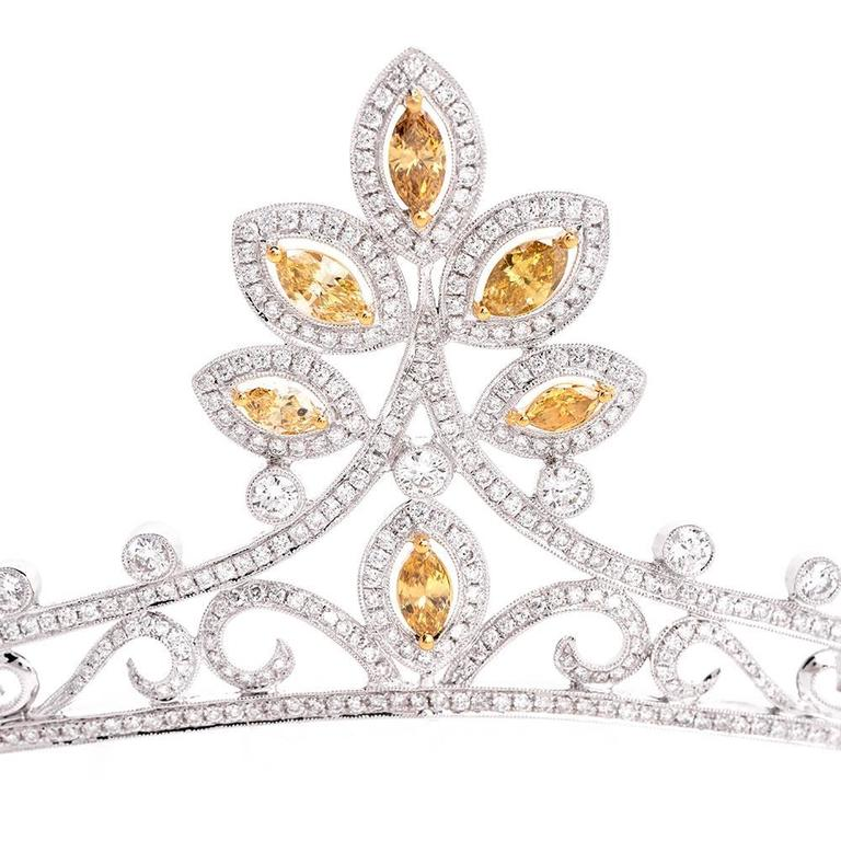 This antique style diamond tiara of immaculate design and craftsmanship is crafted in solid 18K white gold. This alluring 'Napoleonic' hair ornament is designed as an enchanting assemblage of 6 graduated marquise-shaped profiles, each exposing a