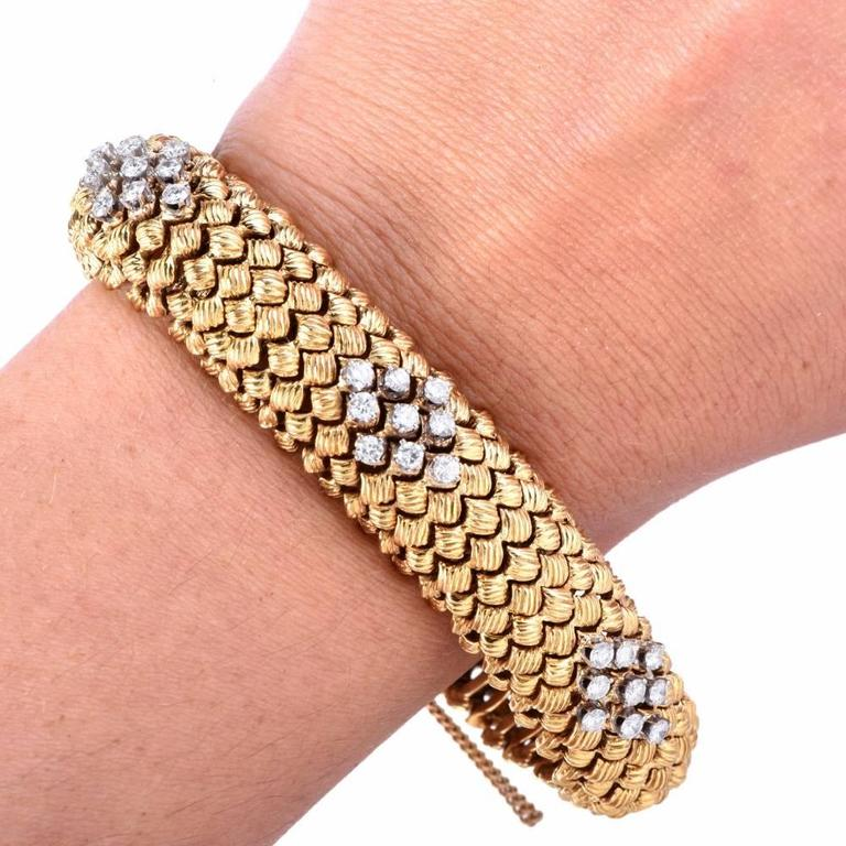 This artfully designed and meticulously crafted 1960s flexible link vintage bracelet is rendered in solid 18K, elegantly matted  hammered nugget yellow gold, with a touch of white gold applied to the diamond settings. Simulating a fascinating mesh