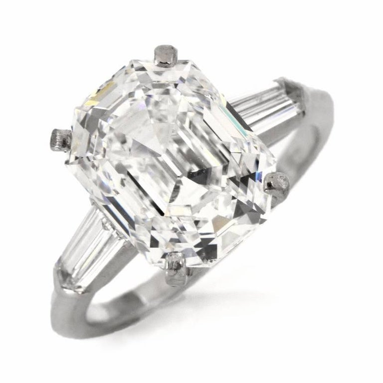 This Breathtaking diamond engagement ring is crafted in solid platinum. It Centered 5.09 carats F color , IF (Internally flawless) clarity, emerald-cut diamond with very good proportions , GIA certified set in a classic platinum mounting . This