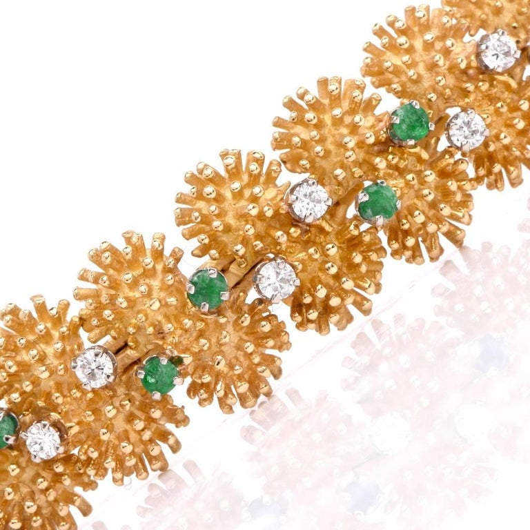 his Vintage Diamond and Emerald bracelet in crafted in 18 karats yellow gold. This 1980's enchanting bracelet displays throughout with 24 genuine round full cut diamonds approximately 1.06 carats and accented with 24 genuine emeralds approximately