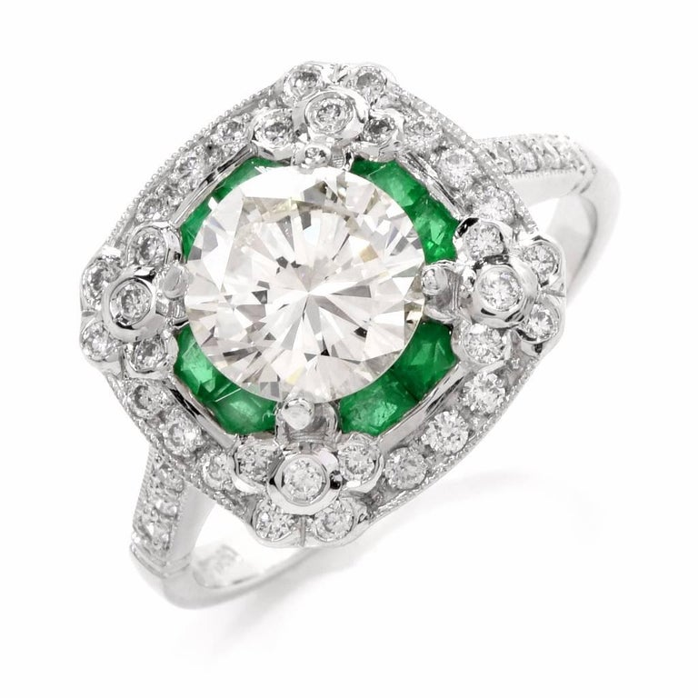 Celebrate the love of a lifetime with this gorgeous sparkling art deco design engagement ring. Finely crafted in solid platinum, it is centered with 1 genuine sparkling round cut diamond approx. 1.42carat, J-K color, VS clarity. The center stone is