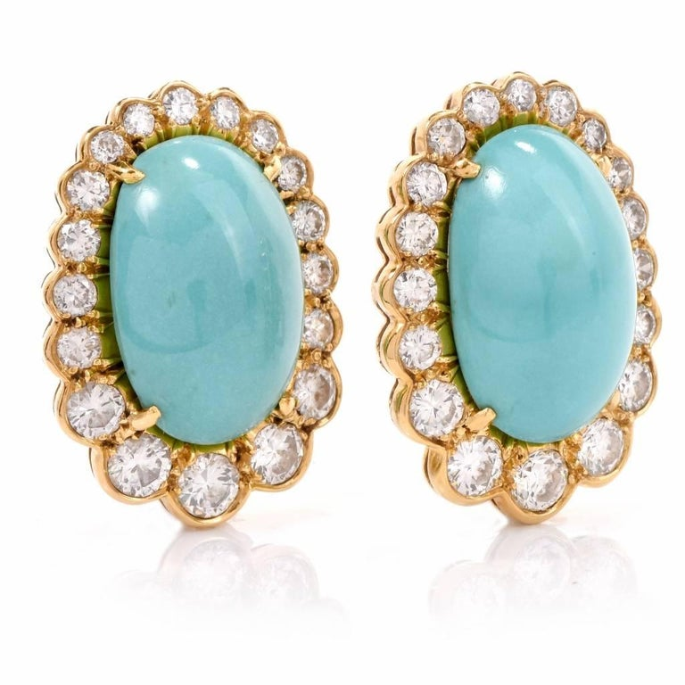 These fabulous vintage clip back earrings. Finely crafted in solid 18K yellow gold, these earrings feature 2 genuine cabochon Persian turquoise approx. 32.50 carats, and are set in a sparkling halo of 38 genuine round cut diamonds approx. 5.30