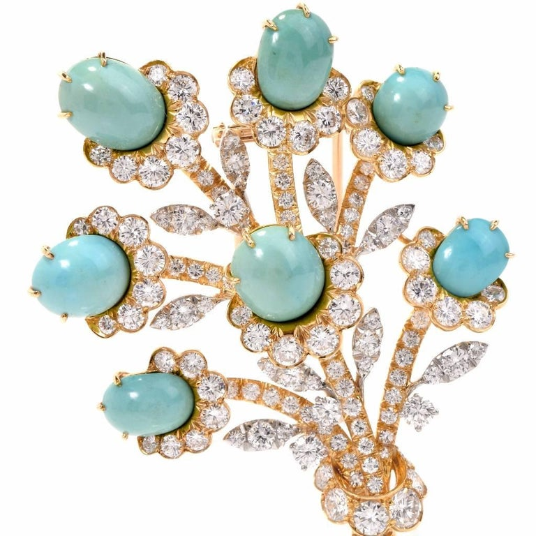 This magnificent 1960's vintage Van Cleef and Arpel flower Brooch Pin is crafted in solid 18K yellow gold. It is decorated with 7 genuine Genuine Persian turquoise approx. 31.00 carats and Leaves and branches are set with some High quality round