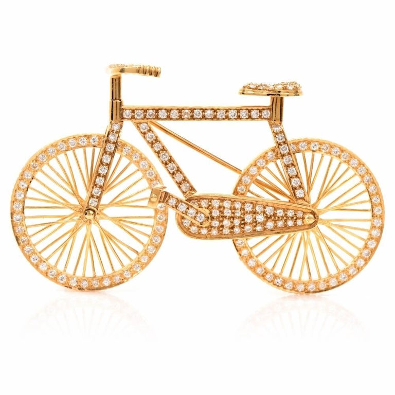 This adorable Estate bicycle figurine pin brooch is handcrafted in solid 18K yellow gold. Displaying a lovely and delicately designed bicycle motif, this brooch is embellished with 183 genuine round cut Diamonds approx: 2.75cttw, H-I color, VS