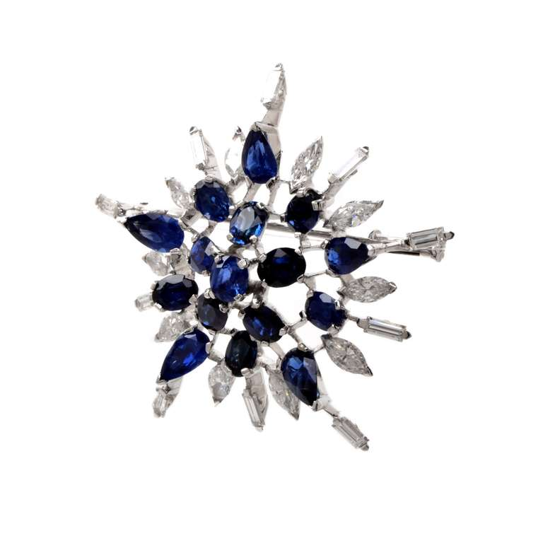 """This conspicuous vintage diamond and sapphire star brooch of unsurpassed elegance  and aesthetic appeal is crafted in solid platinum, weighing approx. 18.8 grams and measuring 1.85"""" wide. Reminiscent of the most popular mid-Victorian star-burst"""
